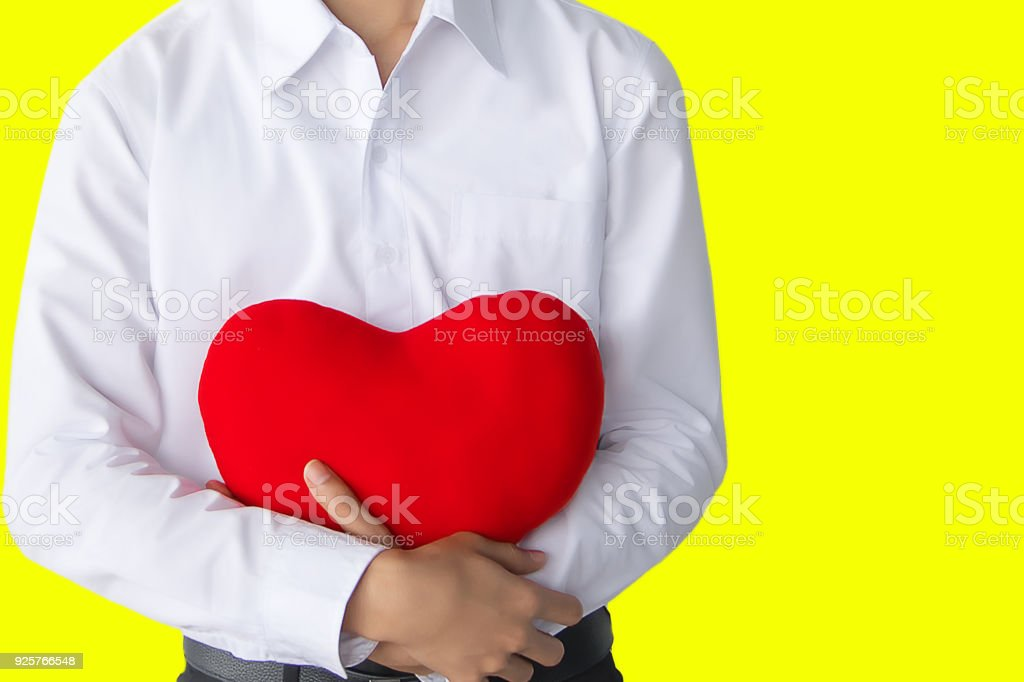 Asian man with red heart on isolated background.For life, insurance, caring, care and loving family image stock photo
