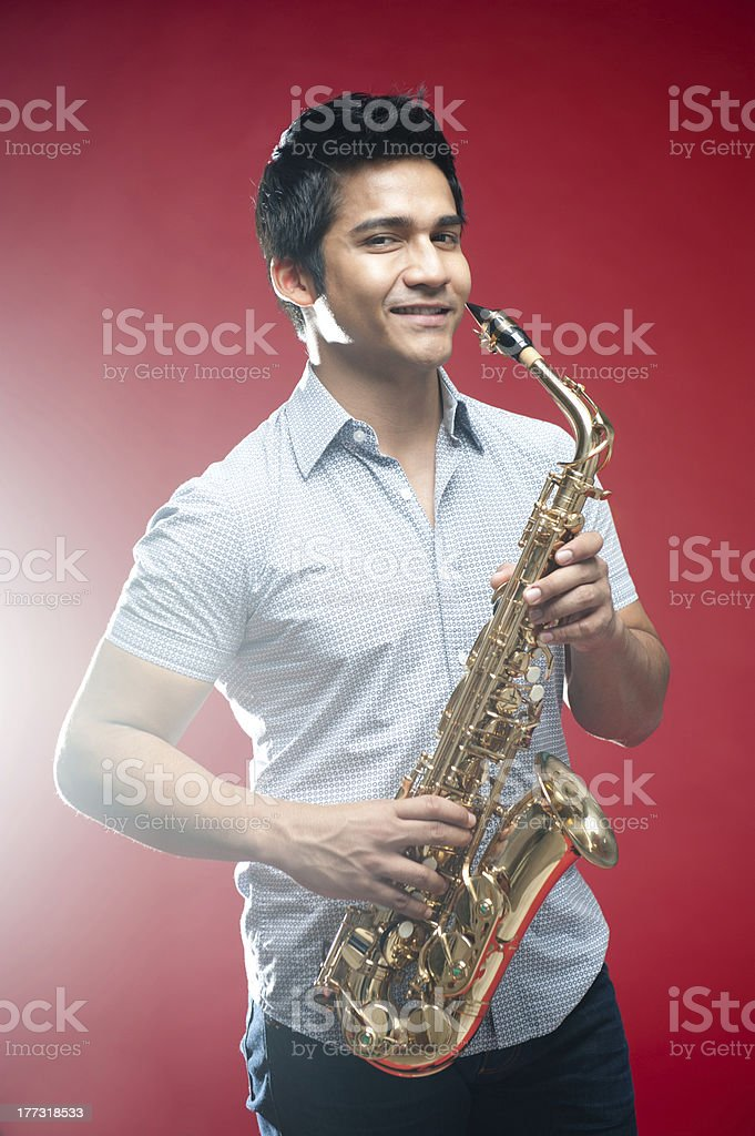 Asian Man with saxophone royalty-free stock photo