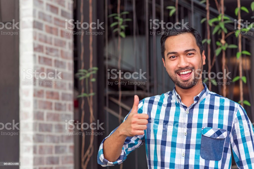 Asian man with thumb up royalty-free stock photo