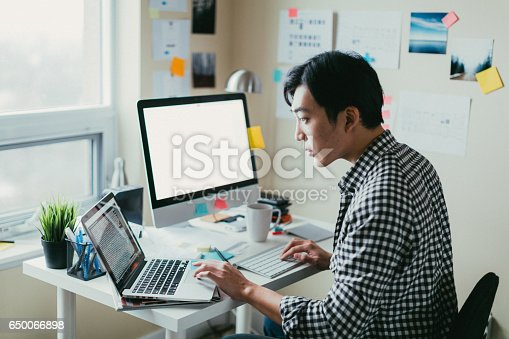 istock Asian man working at a comptuer 650066898