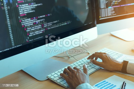 istock Asian man working code program developer computer web development working design software on desk in office. 1128132158