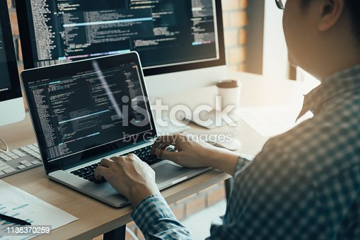 istock Asian man working development of programming and encryption technology website design programmers on desk in office. 1138370259