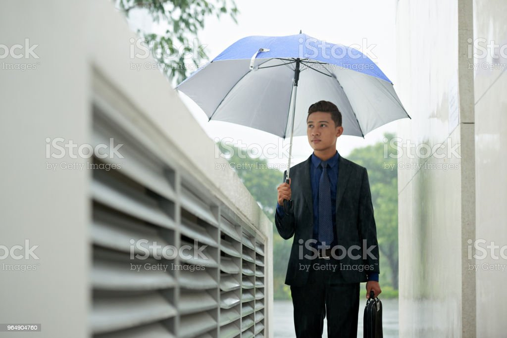 Asian Manager Walking in City Center royalty-free stock photo