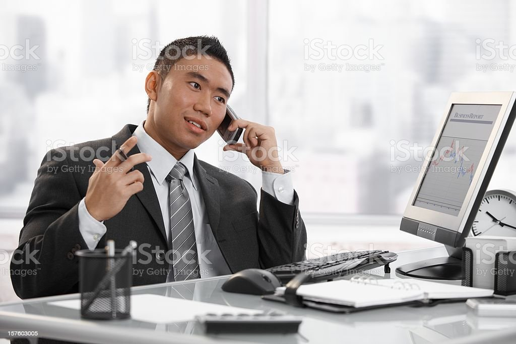 Asian manager working in office royalty-free stock photo