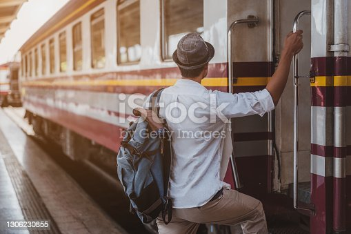 Asian men are boarding the train to travel on vacation.Holiday, journey, trip and summer Travel concept.