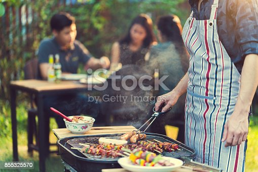 istock Asian men are cooking for a group of friends to eat barbecue 855325570