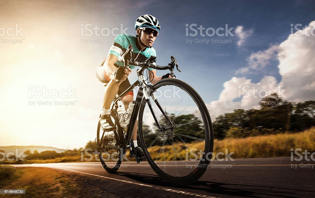 Asian men are cycling road bike in the morning - fotografia de stock