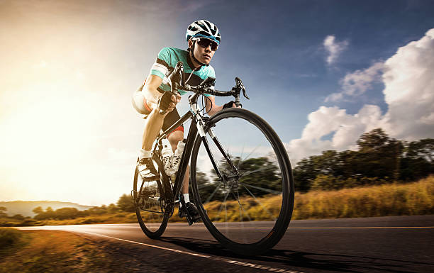 Asian men are cycling road bike in the morning stock photo