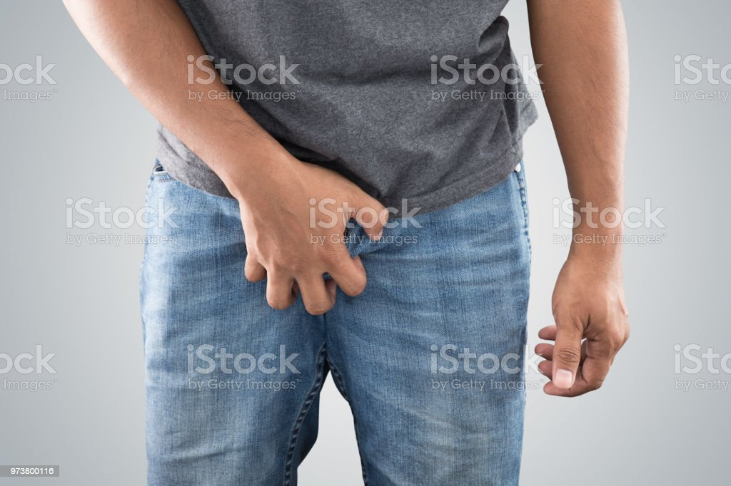 Asian men grab or cover his crotch. stock photo
