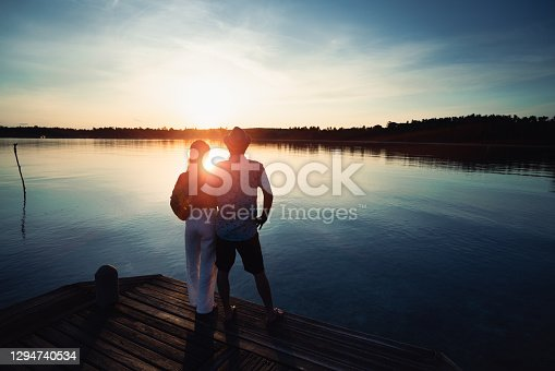 Asian middle aged couple standing at coast on a sunny, Koh Mak Thailand