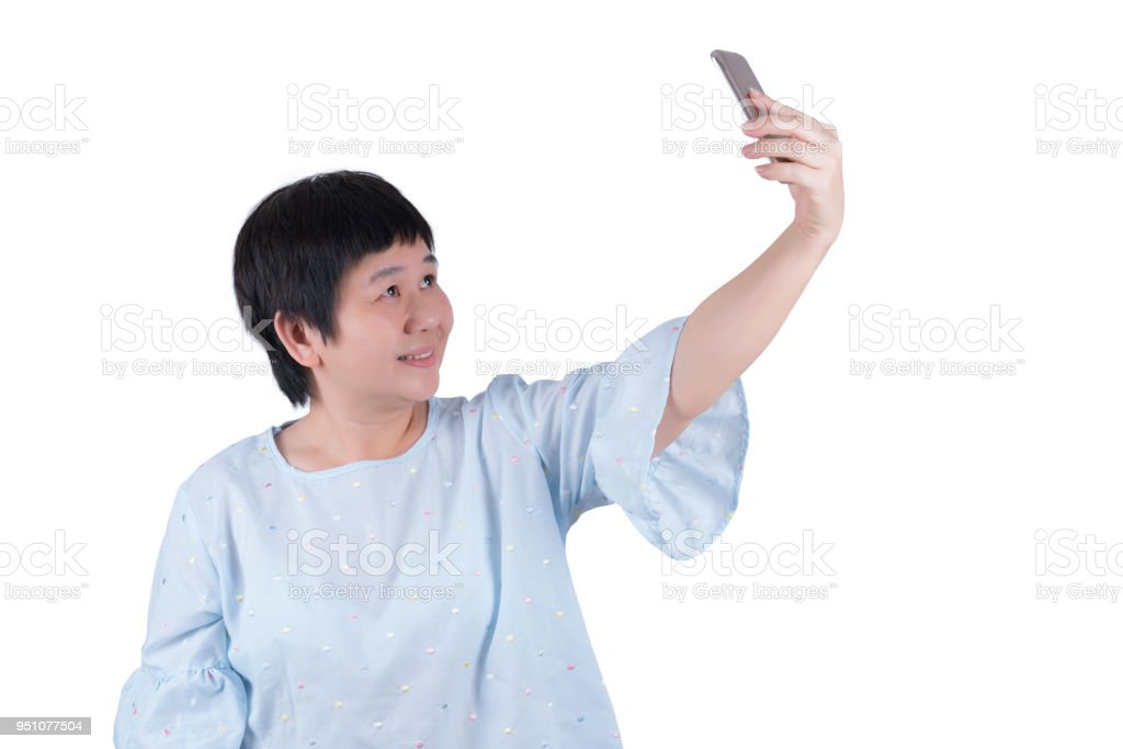 Asian Middle-aged woman taking selfies isolated on white background stock photo