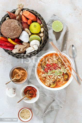 Asian Mie Noodle Soup with Tofu, Peanut, Lime and Chili as Flat Lay
