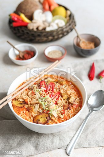 Asian Mie Noodle Soup with Tofu, Peanut, Lime and Chili in creamy coconut milk broth