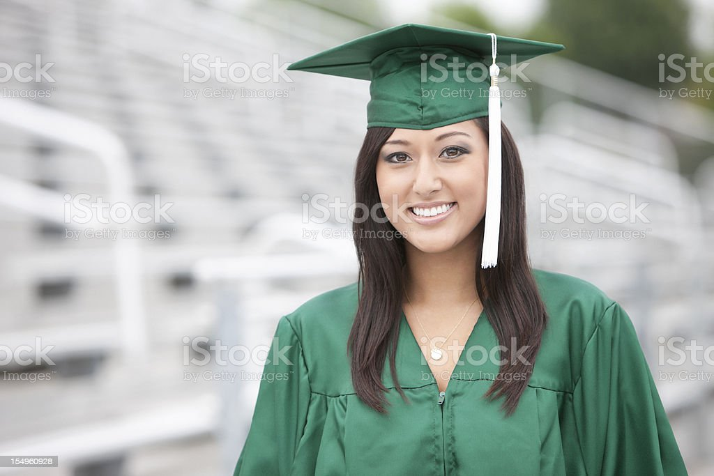 Asian Mixed Young Woman Graduate Portrait in Stadium, Copy Space stock photo