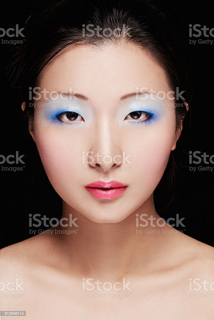 Asian model with colorful makeup. Cosmetic beauty image. stock photo