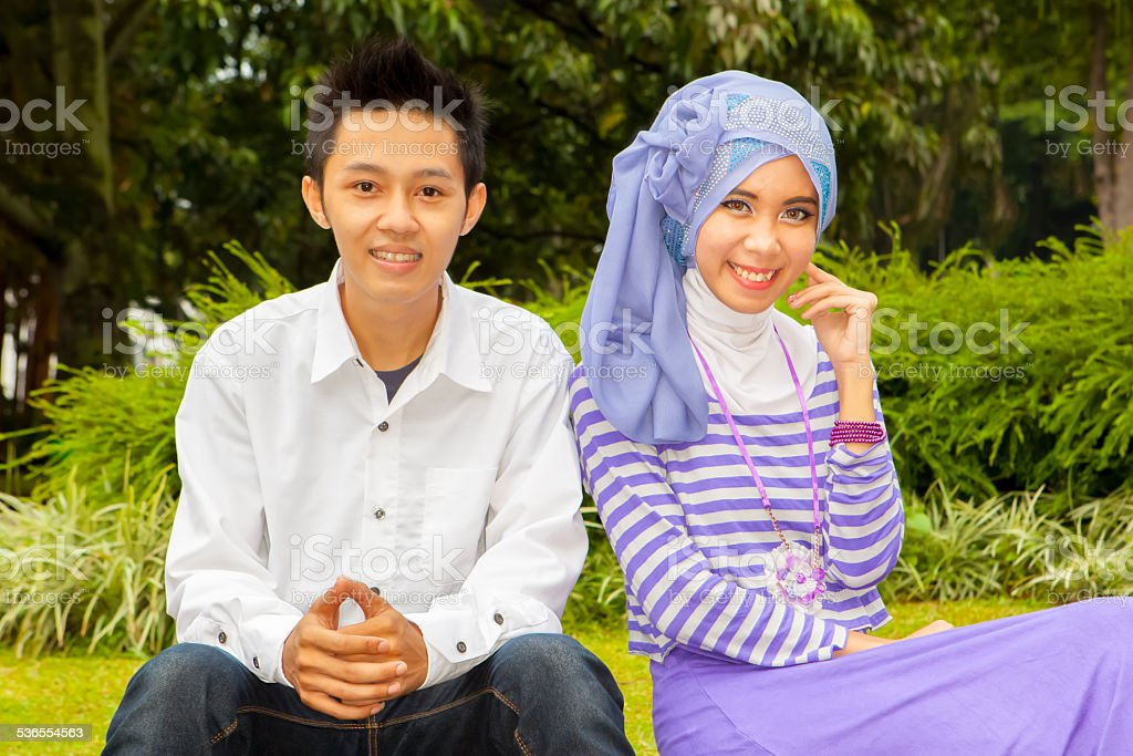 Asian Moslem couple smiling and posing with happy face stock photo
