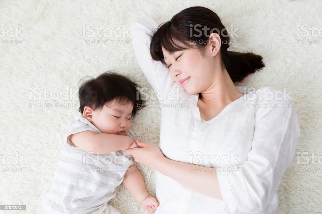 asian mother and baby in living room stock photo