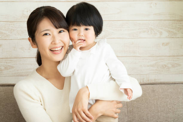 asian mother and baby - stay at home parent stock pictures, royalty-free photos & images