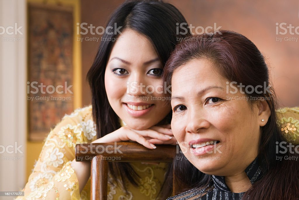 Asian Mother and Daughter Family in Vietnamese Ethnic Traditional Setting stock photo