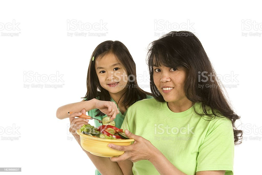 Asian mother and daughter with healthy salad royalty-free stock photo