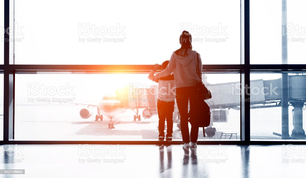 Asian mother and son at airport stock photo