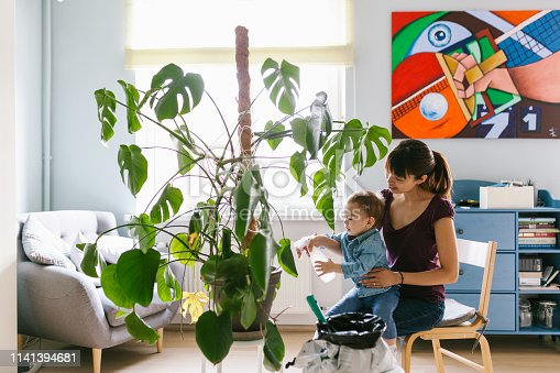 Plant care at home series with Japanese man, woman and child.