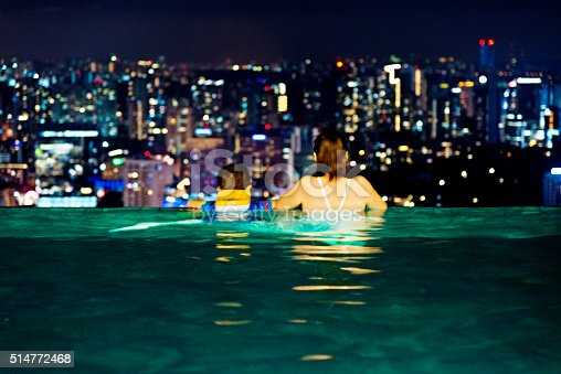 istock Asian mother and son relaxing on hotel rooftop 514772468