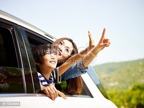 istock asian mother and son traveling by car 817342644