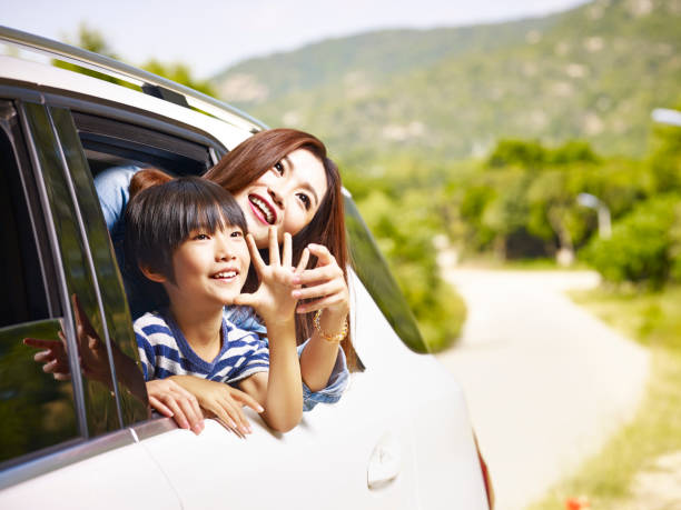 asian mother and son traveling by car - asian travel in car stock photos and pictures