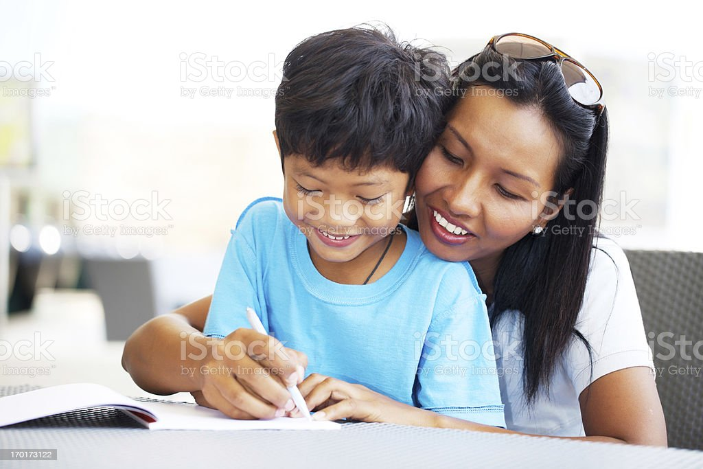 Asian mother helping her son with his homework royalty-free stock photo