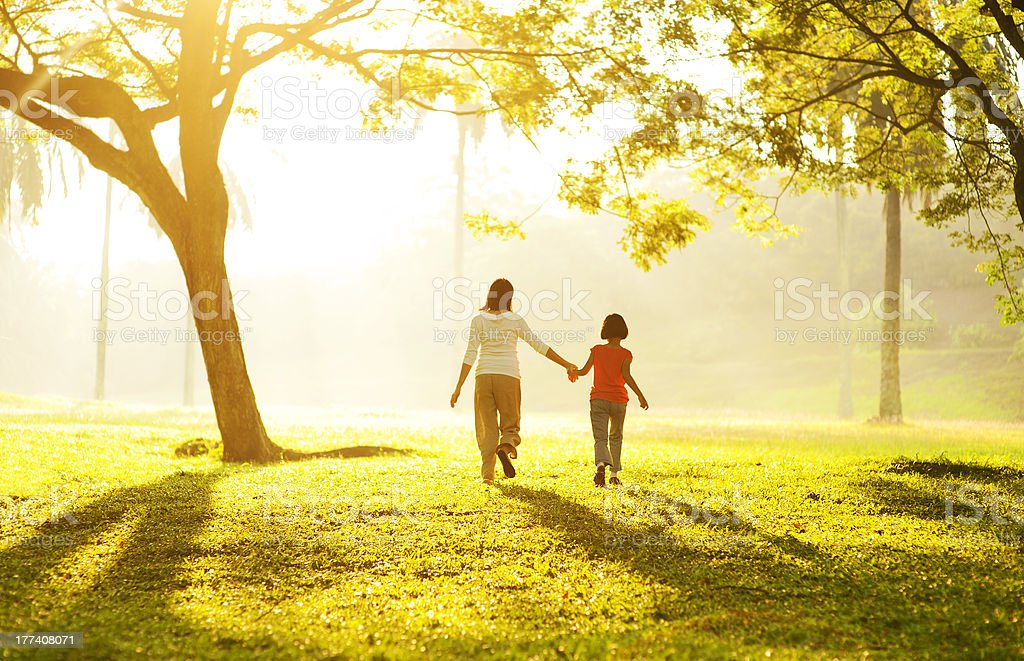 Asian mother holding her daughter's hand stock photo