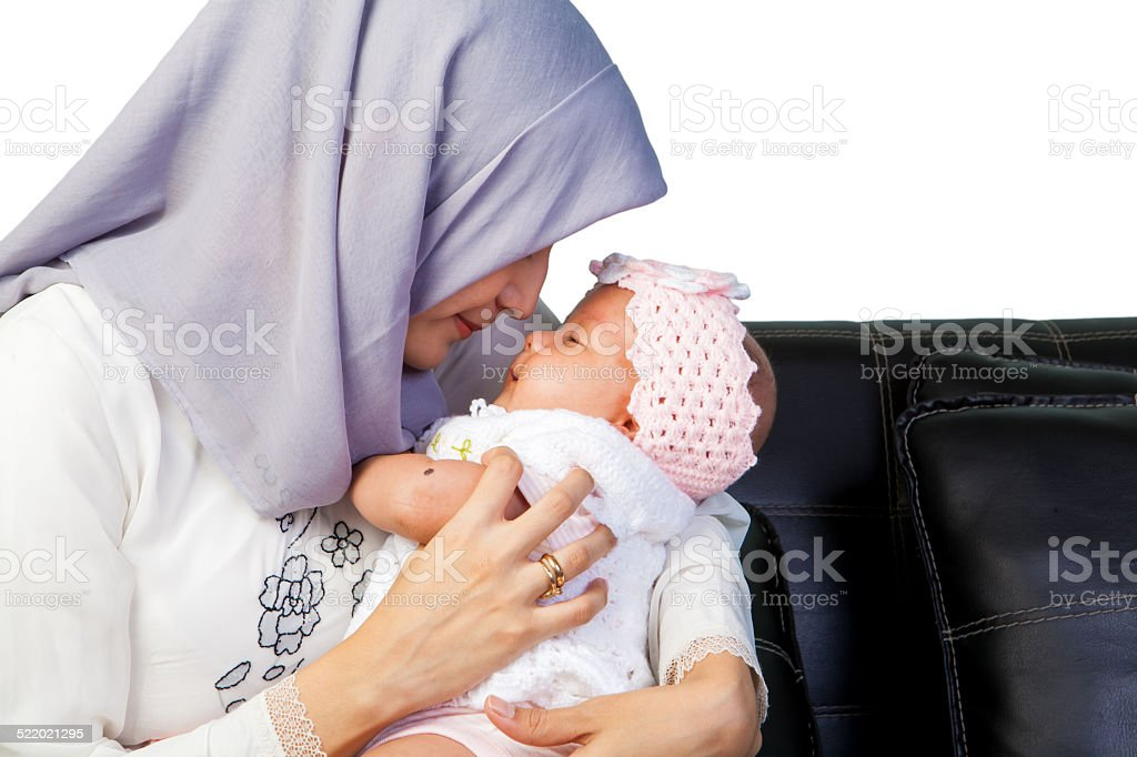Asian Mother Moslem with her newborn baby girl stock photo