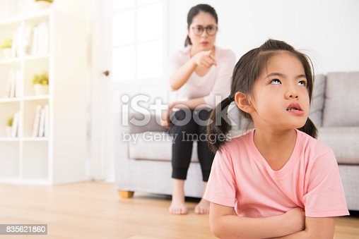 istock asian mother sitting on the sofa angry pointing 835621860
