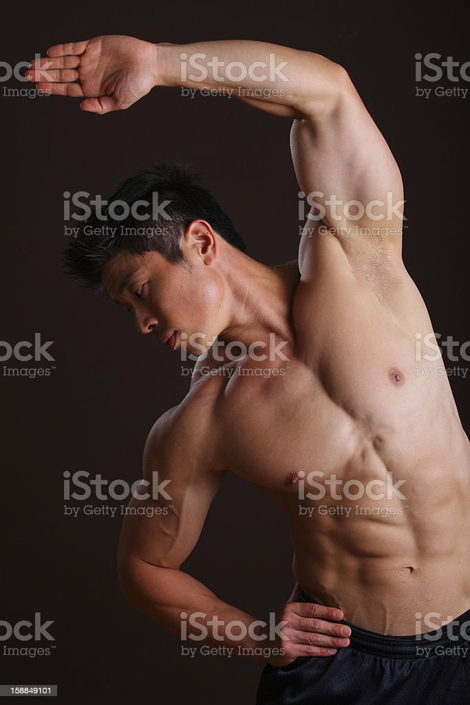 Asian Muscle man stretching left Arm stock photo