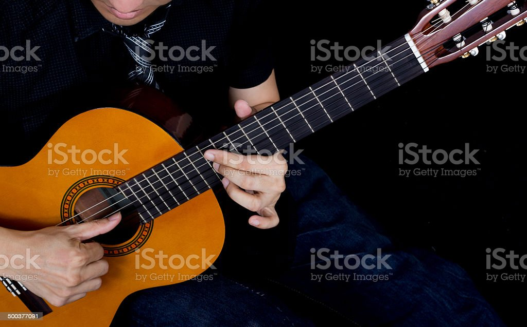 Asian Musician plays Acoustic Guitar stock photo