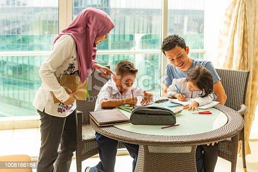istock Asian Muslim Family Doing Homework Together 1008186184
