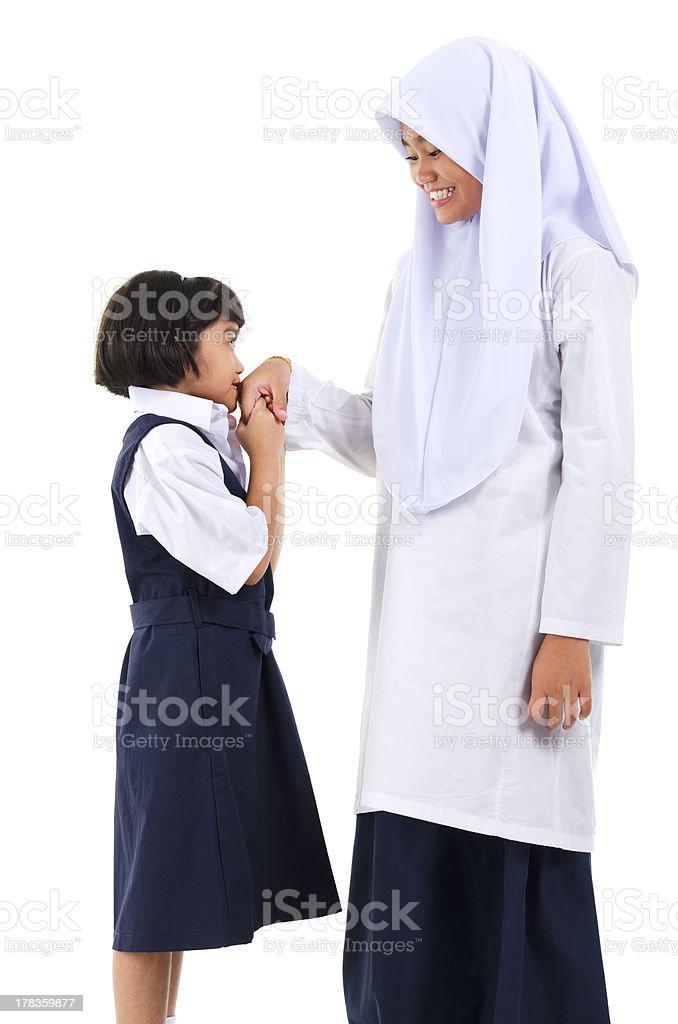 Asian Muslim girl greeting royalty-free stock photo