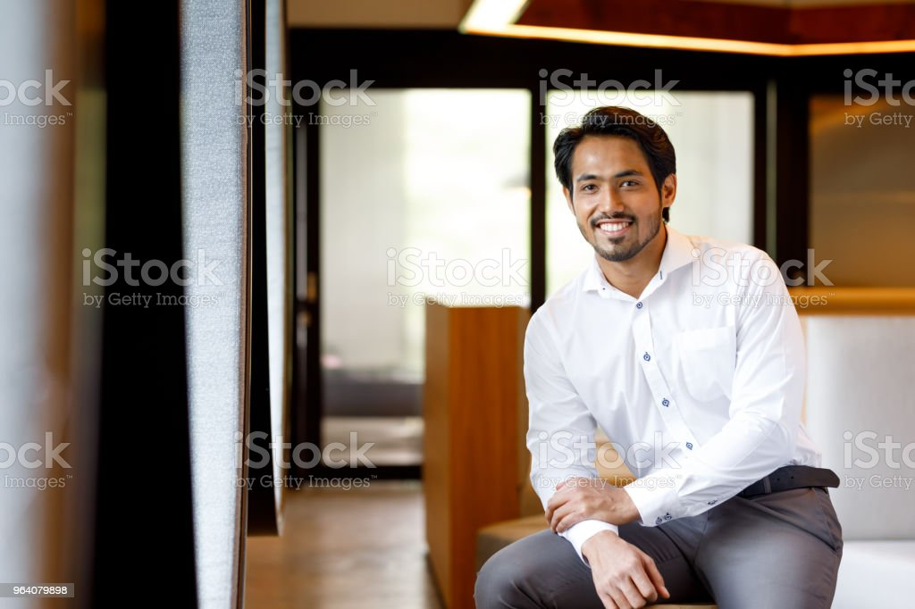 Asian Muslim Man In Modern Office stock photo