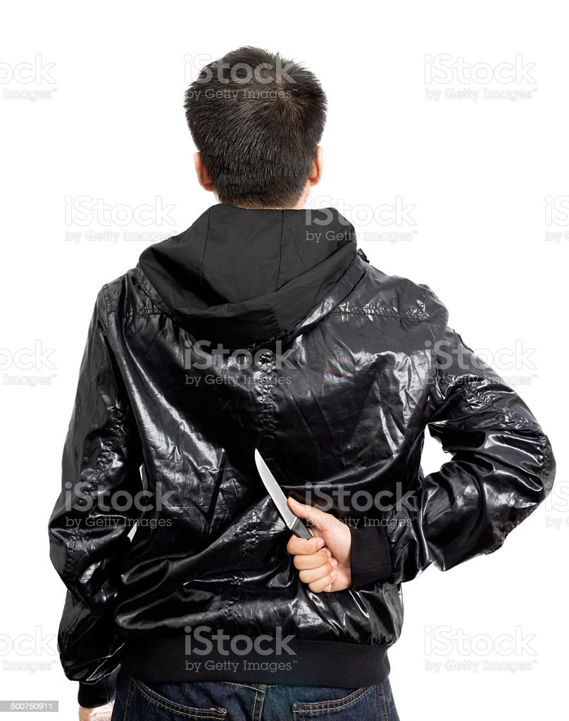 Asian mysterious man hide knife in the back stock photo