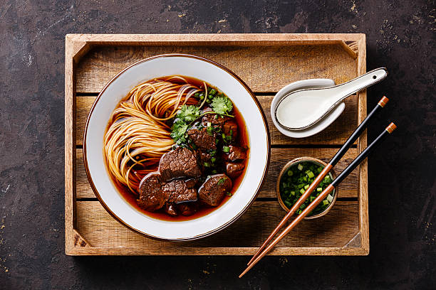 Asian noodles with Beef in wooden tray stock photo
