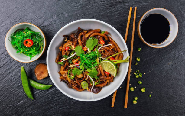 asian noodles with spicy soy sauce and chicken - chinese food stock photos and pictures