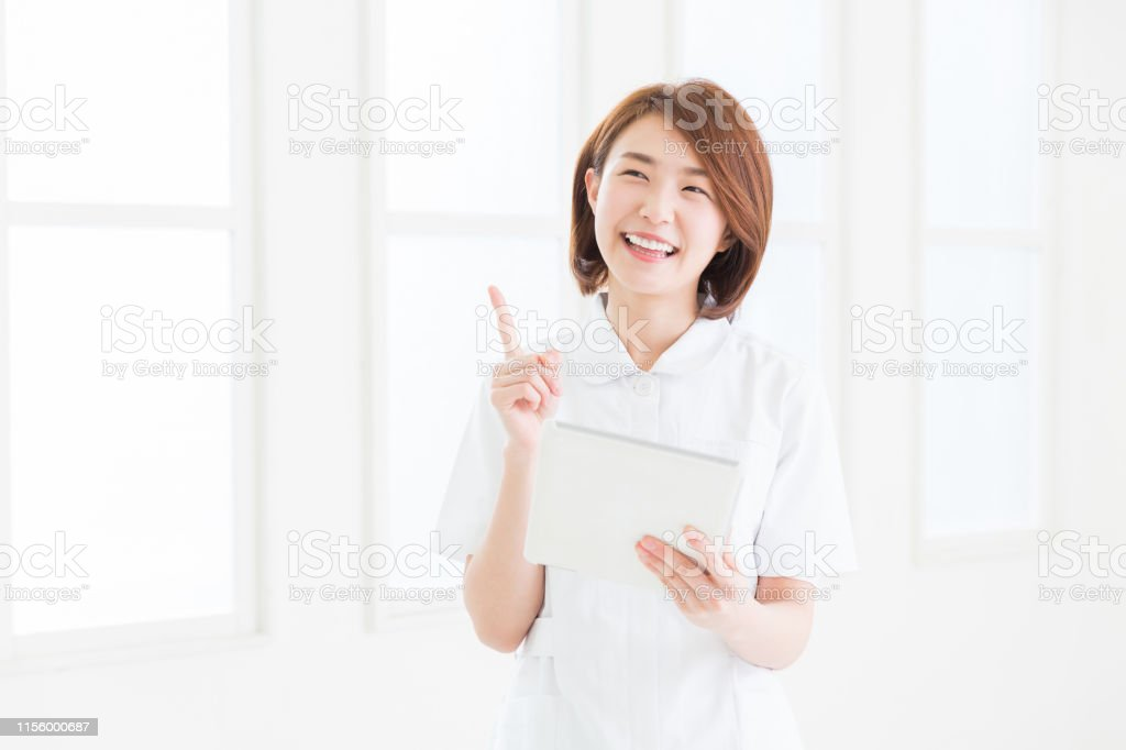attractive asian nurse of the smile,tablet computer,