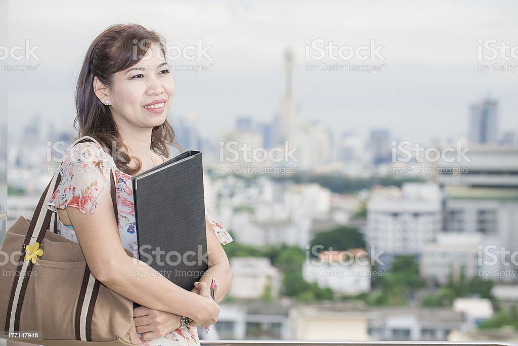 Asian office women with document on city background royalty-free stock photo