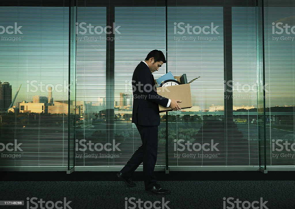 Asian Office Worker Leaving His Job in Layoff for Recession stock photo