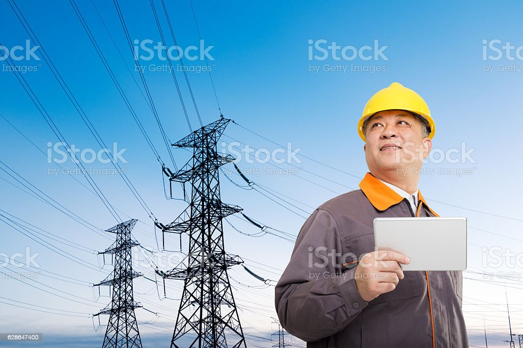 asian old man engineer with tablet and pylons stock photo