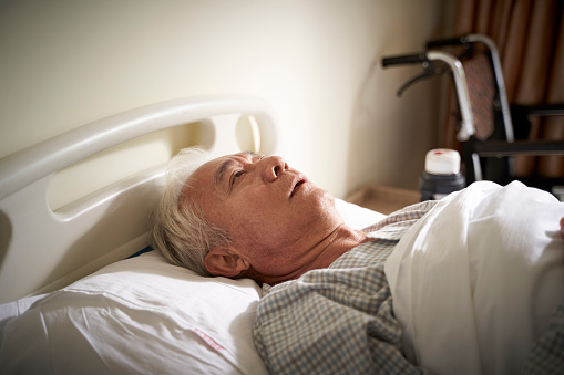 1049772134 istock photo asian old man lying alone in hospital bed 1208062514