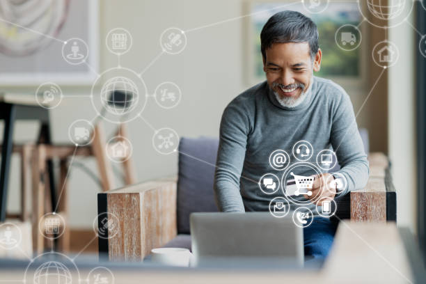 asian or hispanic man using laptop and credit card payment shopping online with icon customer network connection on screen and connecting with omni channel system. older man satisfied with crm system - omnichannel marketing stock photos and pictures