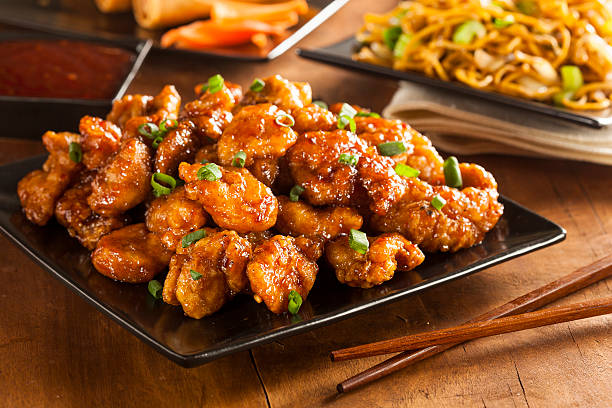 asian oranage chicken with green onions - chinese food stock photos and pictures