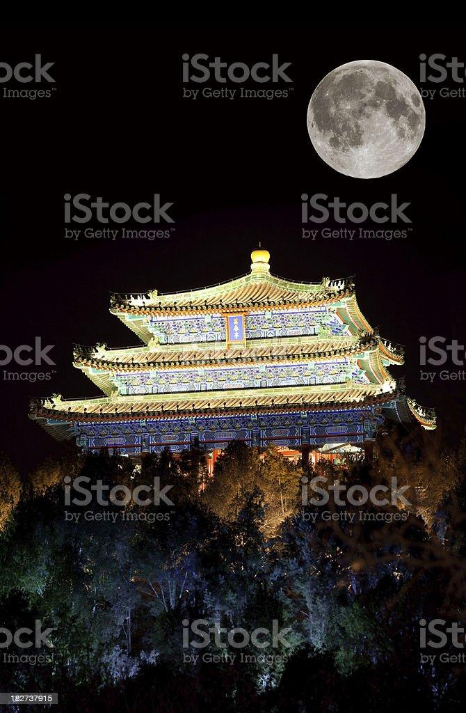 Asian pagoda at night with big moon royalty-free stock photo