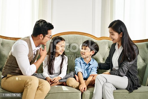 1070262182 istock photo asian parents and children chatting at home 1155278732